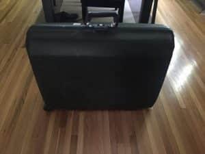 side hustle Samsonite suitcase